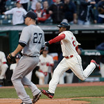 Cleveland Indians' Michael Bourn, right, scores on New York Yankees relief pitcher Shawn Kelley's, left, wild pitch in the eighth inning of a home opener baseball game, Monday, April 8, 2013 …