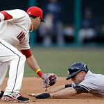 New York Yankees' Brett Gardner, right, is tagged out by Cleveland Indians' Asdrubal Cabrera in the fourth inning of a home opener baseball game, Monday, April 8, 2013, in Cleveland. Gardner …