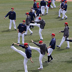 The Cleveland Indians stretch before the Indians play the New York Yankees in a home opener baseball game, Monday, April 8, 2013, in Cleveland. (AP Photo/Tony Dejak)