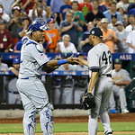 American League's Mariano Rivera, of the New York Yankees, is congratulated by catcher Salvador Perez, left, of the Kansas City Royals, after the eighth inning of the MLB All-Star baseball …