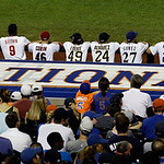 National League players watch from the dugout  during the sixth inning of the MLB All-Star baseball game, on Tuesday, July 16, 2013, in New York. (AP Photo/Julio Cortez)