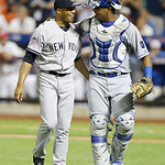 American League's Mariano Rivera, of the New York Yankees, is congratulated by catcher Salvador Perez, right, of the Kansas City Royals, after the eighth inning of the MLB All-Star basebal …