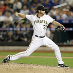 National League's Jason Grilli, of the Pittsburgh Pirates, pitches during the ninth inning of the MLB All-Star baseball game, on Tuesday, July 16, 2013, in New York. (AP Photo/Kathy Willen …