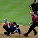 A security guard tackles a fan that ran on the field during the MLB All-Star baseball game, on Tuesday, July 16, 2013, in New York. (AP Photo/Frank Franklin II)