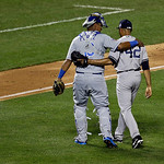 American League's Mariano Rivera, of the New York Yankees, walks off the field with catcher American League's Salvador Perez, of the Kansas City Royals, after pitching during the eighth  …