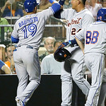 American League's Miguel Cabrera, of the Detroit Tigers, is congratulated by American League's Jose Bautista (19), of the Toronto Blue Jays, after scoring on Bautista's sacrifice fly dur …