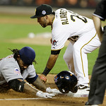American League's Prince Fielder, of the Detroit Tigers, is safe at third as National League's Pedro Alvarez, of the Pittsburgh Pirates, attempts to make the tag on a triple by Fielder d …