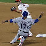 American League's Nelson Cruz, of the Texas Rangers, is out at second as National League's Matt Carpenter, of the St. Louis Cardinals, turns a double play on a ball hit by Edwin Encarnac …