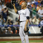 American League's Mariano Rivera, of the New York Yankees,  acknowledges a standing ovation during the eighth inning of the MLB All-Star baseball game, on Tuesday, July 16, 2013, in New Yo …