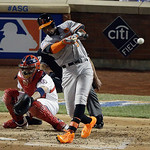 American League's Adam Jones, of the Baltimore Orioles, hits a double during the MLB All-Star baseball game, on Tuesday, July 16, 2013, in New York. (AP Photo/Frank Franklin II)
