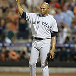 American League's Mariano Rivera, of the New York Yankees, acknowledges a standing ovation during the eighth inning of the MLB All-Star baseball game, on Tuesday, July 16, 2013, in New Yor …