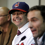 Cleveland Indians' Nick Swisher, center, smiles as he and manager Terry Francona, left, listen to general manager Chris Antonetti, right, answer questions during a baseball news conference,  …