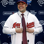 Cleveland Indians' Nick Swisher buttons his new jersey during a baseball news conference, Thursday, Jan. 3, 2013, in Cleveland. Swisher passed his physical with the Indians on Thursday and s …