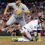 Cleveland Indians' pitcher Justin Masterson, left, races for the loose ball as Minnesota Twins Michael Cuddyer scores from third on Masterson's wild pitch in the third inning of a baseball g …