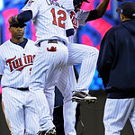 Minnesota Twins' Alexi Casilla (12) and Denard Span, right, celebrate the Twins' 5-1 win over the Cleveland Indians in a baseball game Tuesday, April 20, 2010 in Minneapolis. At left is Delm …