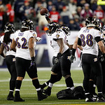Baltimore Ravens defensive end Arthur Jones, center, celebrates his fumble recovery against the New England Patriots during the second half of the NFL football AFC Championship football game …