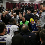 Baltimore Ravens head coach John Harbaugh talks to his team following the NFL football AFC Championship football game against the New England Patriots in Foxborough, Mass., Sunday, Jan. 20,  …