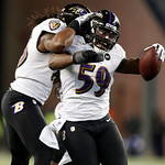 Baltimore Ravens inside linebacker Dannell Ellerbe (59) celebrates his interception of a pass by New England Patriots quarterback Tom Brady during the second half of the NFL football AFC Cha …