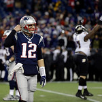 New England Patriots quarterback Tom Brady (12) walks off the field after throwing an interception during the fourth quarter of the NFL football AFC Championship football game against the Ba …