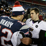 Baltimore Ravens quarterback Joe Flacco, right, talks to New England Patriots quarterback Tom Brady following the NFL football AFC Championship football game in Foxborough, Mass., Sunday, Ja …