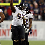 Baltimore Ravens defensive end Arthur Jones (97) celebrates his fumble recovery against the New England Patriots during the second half of the NFL football AFC Championship football game in  …
