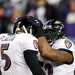 Baltimore Ravens inside linebacker Ray Lewis, right, celebrates with quarterback Joe Flacco (5) during the second half of the NFL football AFC Championship football game against the New Engl …