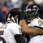 Baltimore Ravens quarterback Joe Flacco (5) and inside linebacker Ray Lewis, right, celebrate near the end of the second half of the NFL football AFC Championship football game against the N …