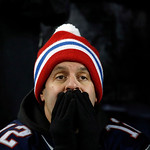 A New England Patriots fan reacts during the second half of the NFL football AFC Championship football game between the New England Patriots and the Baltimore Ravens in Foxborough, Mass., Su …