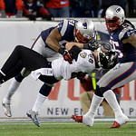 New England Patriots outside linebacker Jerod Mayo (51) tackles Baltimore Ravens tight end Dennis Pitta (88) after a reception during the second half of the NFL football AFC Championship foo …