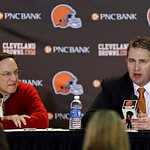 Cleveland Browns head coach Rob Chudzinski, right, discusses the first round of the NFL draft with CEO Joe Banner at the football team's practice facility in Berea, Ohio, Thursday, April 25, …