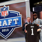 Barkevious Mingo, from Louisiana State, stands with NFL Commissioner Roger Goodell after being selected sixth overall by the Cleveland Browns in the first round of the NFL football draft, Th …