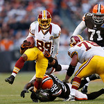 Washington Redskins wide receiver Santana Moss (89) slips a tackle by Cleveland Browns linebacker D'Qwell Jackson (52) in the fourth quarter of an NFL football game in Cleveland, Sunday, Dec …