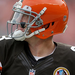 Cleveland Browns quarterback Brandon Weeden watches his pass as he warms up before the Browns play the Washington Redskins in an NFL football game Sunday, Dec. 16, 2012, in Cleveland. Weeden …