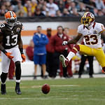 Cleveland Browns wide receiver Josh Gordon can't get to the ball under defense from Washington Redskins cornerback DeAngelo Hall (23) during an NFL football game Sunday, Dec. 16, 2012, in Cl …