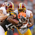 Cleveland Browns wide receiver Greg Little (15) is tackled by Washington Redskins linebacker Ryan Kerrigan (91) and cornerback DeAngelo Hall (23) in the tird quarter of an NFL football game  …