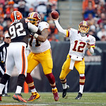 Washington Redskins quarterback Kirk Cousins (12) passes against the Cleveland Browns in the second quarter of an NFL football game in Cleveland, Sunday, Dec. 16, 2012. (AP Photo/Rick Osento …