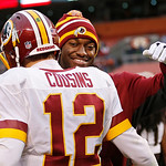 Injured Washington Redskins quarterback Robert Griffin III, right, hugs Kirk Cousins (12) after a 38-21 win over the Cleveland Browns in an NFL football game in Cleveland, Sunday, Dec. 16, 2 …