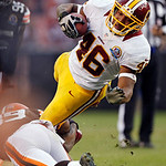 Washington Redskins running back Alfred Morris (46) is tripped by Cleveland Browns cornerback Tashaun Gipson in the fourth quarter of an NFL football game in Cleveland, Sunday, Dec. 16, 2012 …
