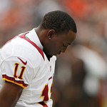 Washington Redskins wide receiver Aldrick Robinson (11) observes a moment of silence for the victims of the Connecticut schol shooting before an NFL football game against the Cleveland Brown …