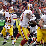 Washington Redskins quarterback Kirk Cousins (12) throws a screen pass to wide receiver Pierre Garcon in the second quarter of an NFL football game Sunday, Dec. 16, 2012, in Cleveland. (AP P …