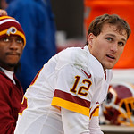 Cleveland Browns quarterback Kirk Cousins (12) watches from the bench with Robert Griffin III in the fourth quarter of an NFL football game against the Cleveland Browns in Cleveland, Sunday, …