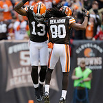 Cleveland Browns wide receiver Josh Gordon (13) celebrates with Cleveland Browns wide receiver Travis Benjamin (80) after a fourth quarter touchdown by Benjamin against the Washington Redski …