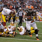 Cleveland Browns running back Trent Richardson (33) scores on a 1-yard touchdown against the Washington Redskins run in the second quarter of an NFL football game Sunday, Dec. 16, 2012, in C …
