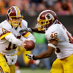 Washington Redskins quarterback Kirk Cousins (12) hands off the ball to running back Alfred Morris during an NFL football game against the Cleveland Browns Sunday, Dec. 16, 2012, in Clevelan …
