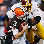 Washington Redskins nose tackle Barry Cofield (96) sacks Cleveland Browns quarterback Brandon Weeden in the fourth quarter of an NFL football game in Cleveland, Sunday, Dec. 16, 2012. The Re …