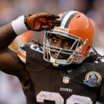 Cleveland Browns running back Trent Richardson salutes the fans after scoring on a 1-yard tochdown run against the Washington Redskins in the second quarter of an NFL football game Sunday, D …