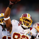 Washington Redskins wide receiver Pierre Garcon celebrates after recovering a fumble by teammate Santana Moss in the fourth quarter of an NFL football game against the Cleveland Browns in Cl …