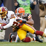 Washington Redskins wide receiver Santana Moss (89) makes a catch against Cleveland Browns linebacker Craig Robertson in the third quarter of an NFL football game Sunday, Dec. 16, 2012, in C …