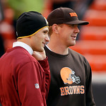 Washington Redskins quarterback Kirk Cousins, left, talks with Cleveland Browns quarterback Brandon Weeden before an NFL football game Sunday, Dec. 16, 2012, in Cleveland. (AP Photo/Mark Dun …