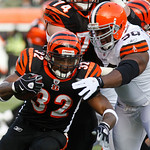 Cincinnati Bengals running back Cedric Benson (32) is tackled by Cleveland Browns defensive end Kenyon Coleman (90) in the first half of an NFL football game, Sunday, Dec. 19, 2010, in Cinci …